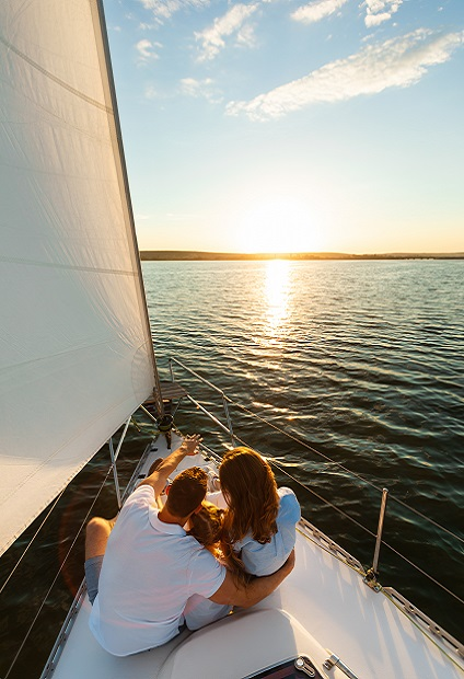 Family Sitting On Yacht Deck Back To Camera Enjoying Sailboat Ride In Sea On Summer Day. Sailing Tour. Vertical
